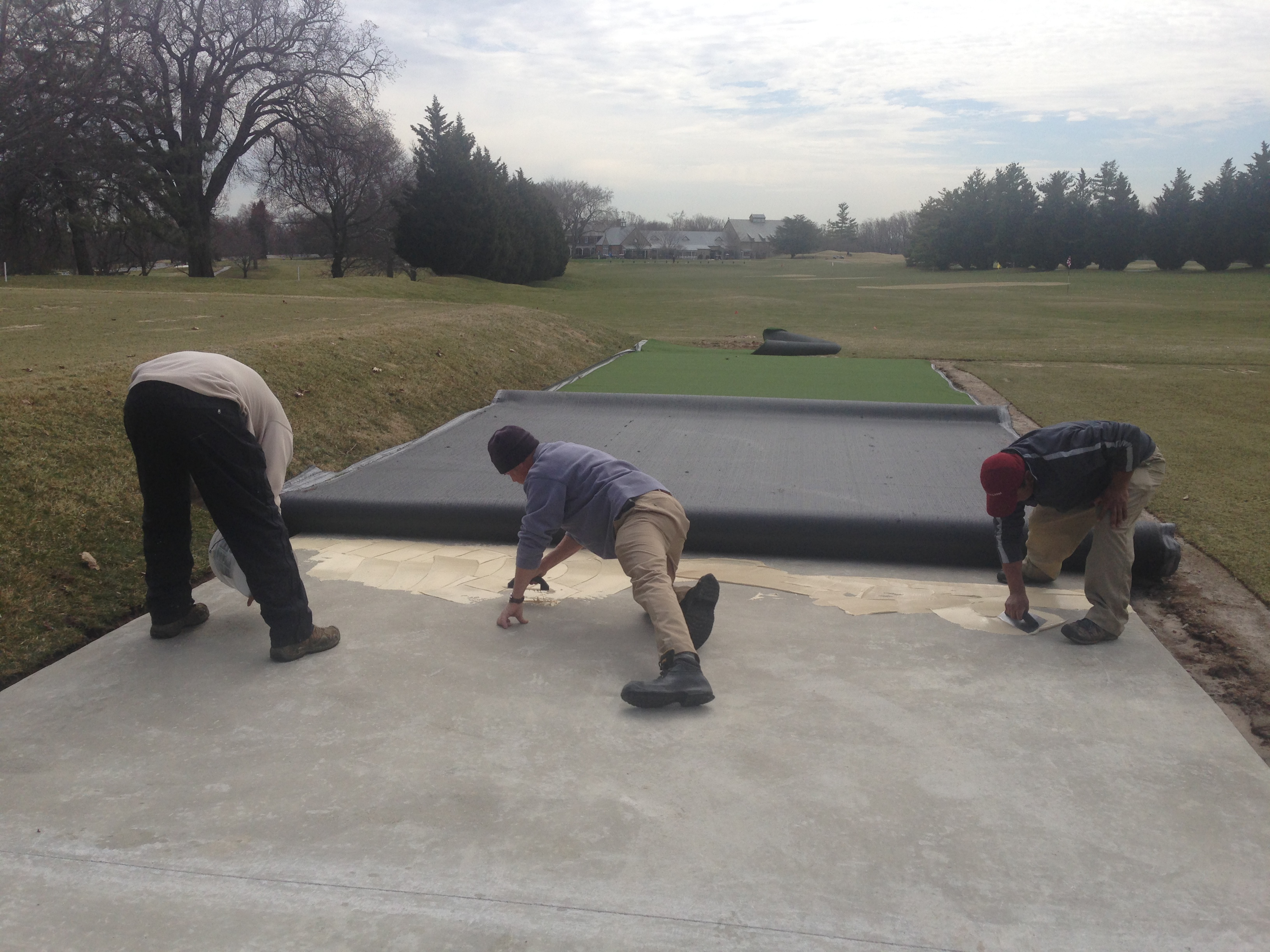 Driving range mat we used an outdoor carpet glue and troweled the glue onto the concrete then we baanklon Images